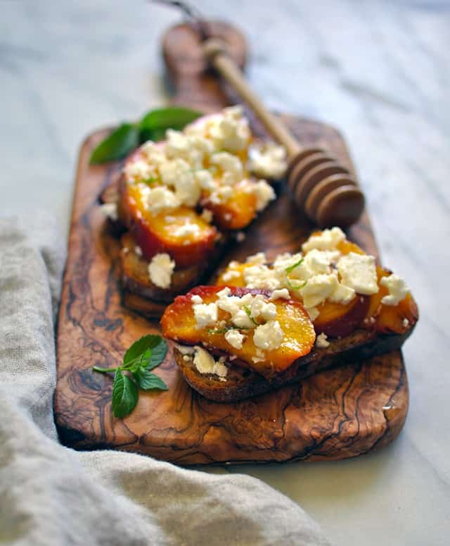 Grilled Peach Crostini with Feta and Fir Honey