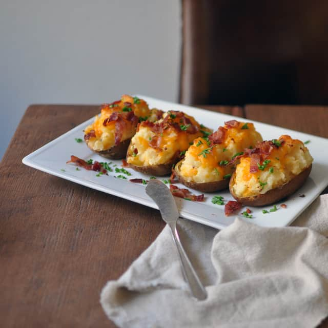 Loaded Twice Baked Potatoes With Bacon Bits Turntable Kitchen