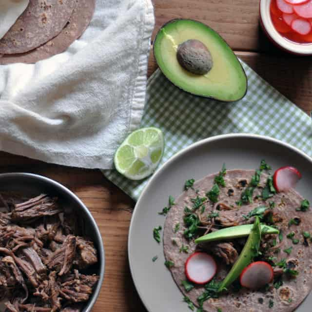 beeftaco overhead Slow Cooked Beef Tacos with Quick Marinated Radishes for Cinco de Mayo