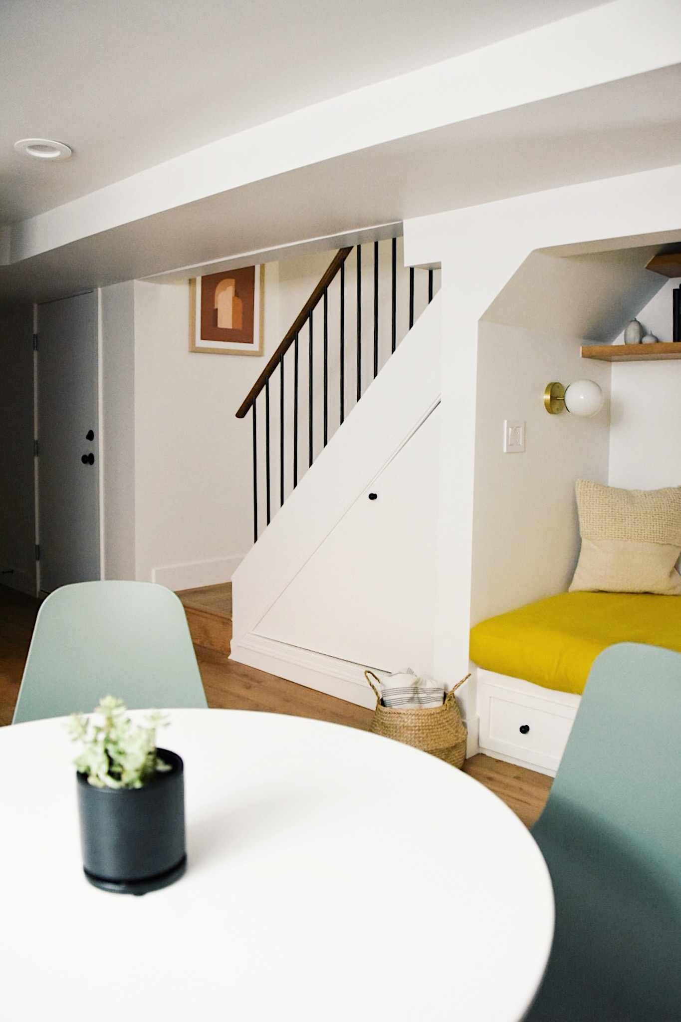 How a Seattle family of five turned a dark family basement in their 1930s tudor into a bright and airy multi-purpose workspace and playroom (with a cozy under stair reading nook!).