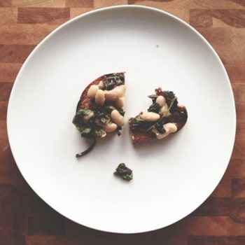 Baby Chard, White Bean, and Anchovy Crostini by Nicole Gulotta