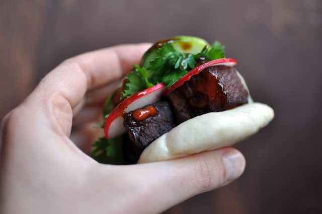 pork buns hand Caramelized Pork Belly Buns Inspired by David Chang