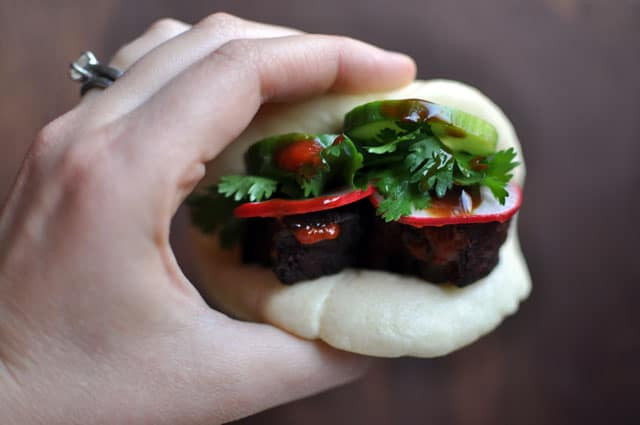pork buns hand side Caramelized Pork Belly Buns Inspired by David Chang