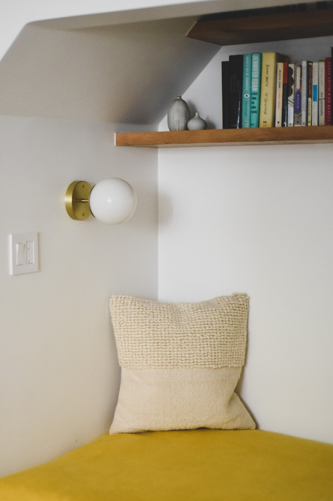 Schoolhouse Electric sconce in reading nook